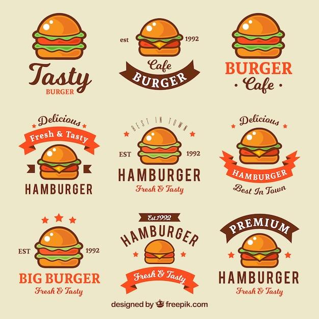 Verscheidenheid van vlakke logo's met gekleurde hamburgers Gratis Vector