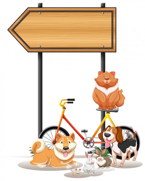Verschillende huisdieren onder het bord Gratis Vector