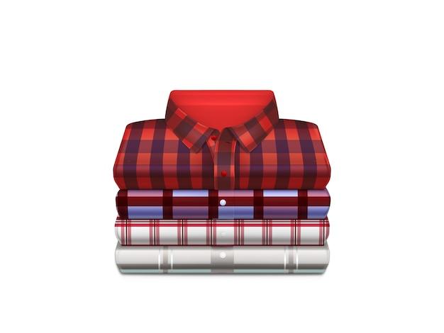 Verschillende kleuren, geruite katoenen shirts gevouwen in stapel Gratis Vector