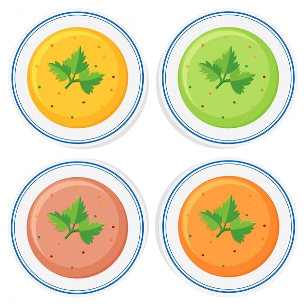 Verschillende soorten soep in kommen Gratis Vector