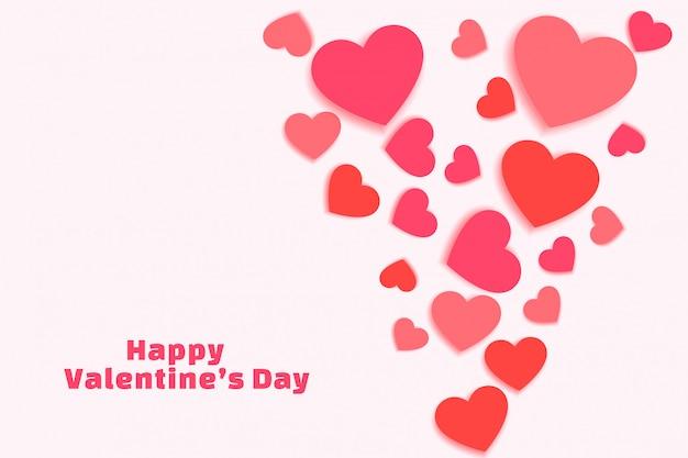 Verspreide valentijnsdag harten in tinten van roze wenskaart Gratis Vector