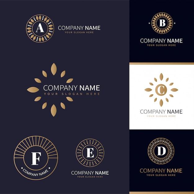 Verzameling van bedrijfslogo's met gouden natuurlijke elementen Premium Vector
