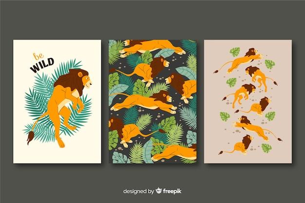 Verzameling van hand getrokken leeuwen kaarten Gratis Vector