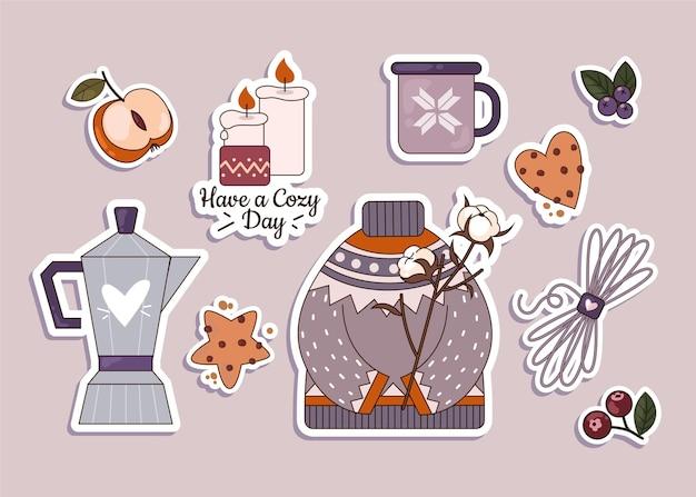 Verzameling van hygge-stickers in plat ontwerp Gratis Vector