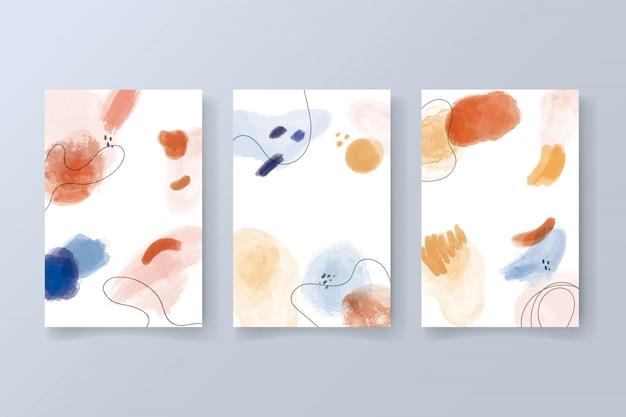 Verzameling van moderne kaarten met aquarel vormen Gratis Vector