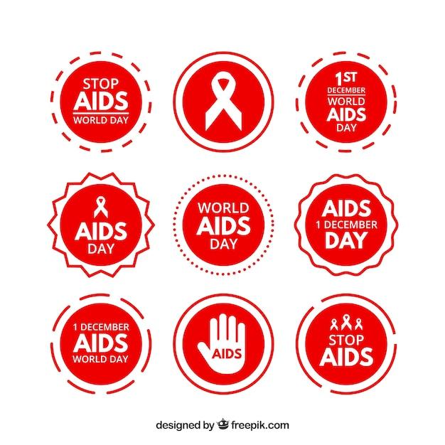 Verzameling van rode aids werelddag stickers Gratis Vector
