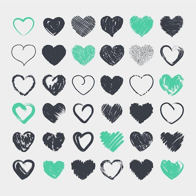 Verzameling van schattige harten in potlood hand getrokken Gratis Vector