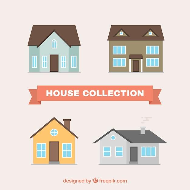 Vier huizen in plat design Gratis Vector