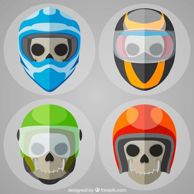 Vier schedels met gekleurde helmen Gratis Vector