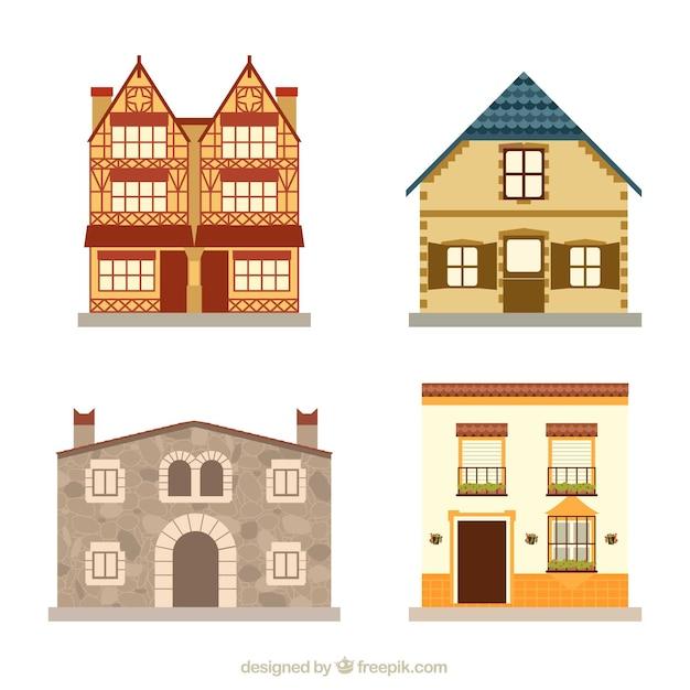 Vier verschillende huizen Gratis Vector