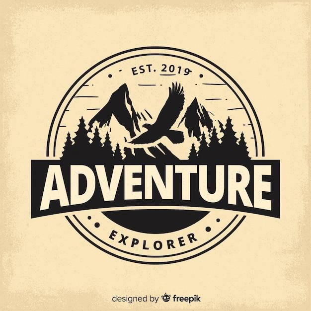 Vintage avontuur logo achtergrond Gratis Vector