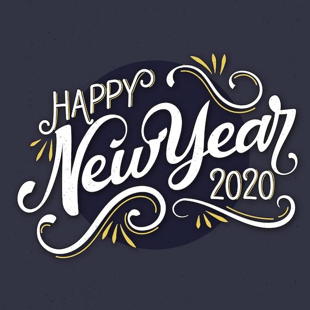 Vintage belettering gelukkig nieuw jaar 2020 backrgound Gratis Vector