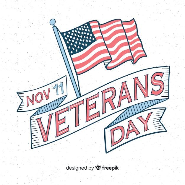 Vintage belettering voor veteranendag met vlag Gratis Vector