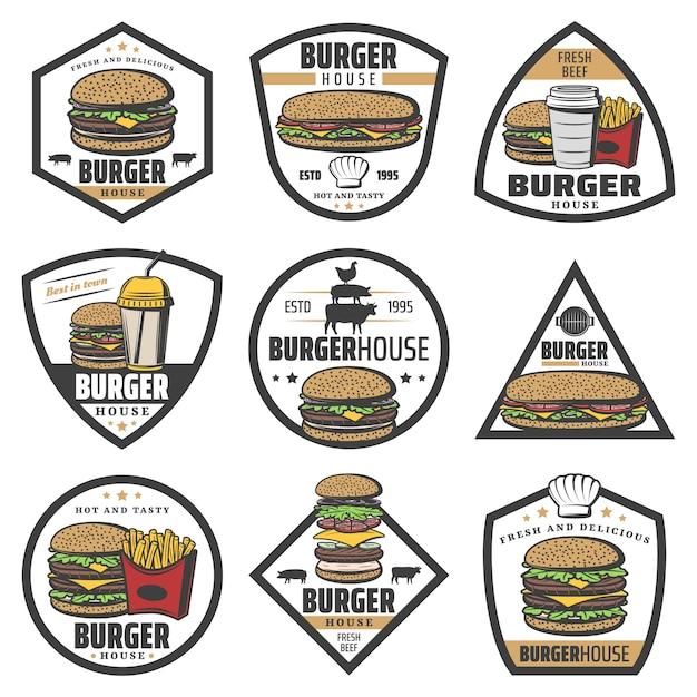 Vintage gekleurde hamburgeretiketten met sandwich frietjes frisdrank en cheeseburger ingrediënten geïsoleerd Gratis Vector