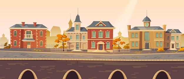 Vintage herfst stadsstraat met europese koloniale victoriaanse gebouwen en promenade langs het meer Gratis Vector
