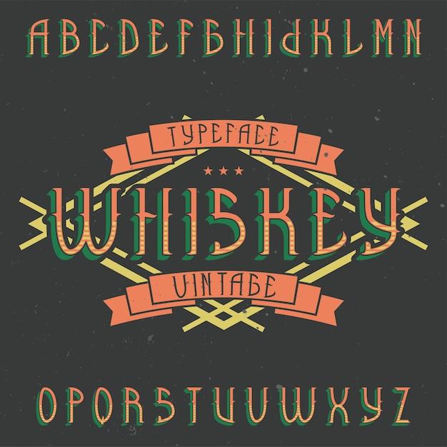 Vintage label lettertype met de naam whiskey. goed lettertype om te gebruiken in vintage labels of logo. Gratis Vector