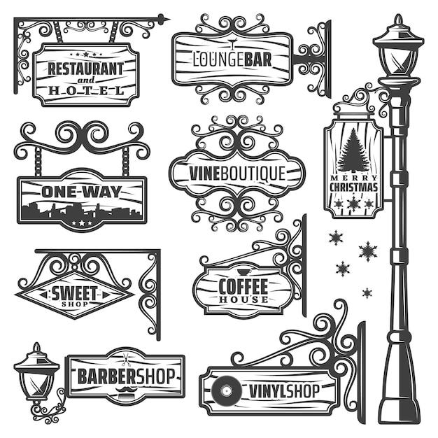 Vintage labels voor straatlantaarns met metalen paalinscripties op houten borden en planken Gratis Vector