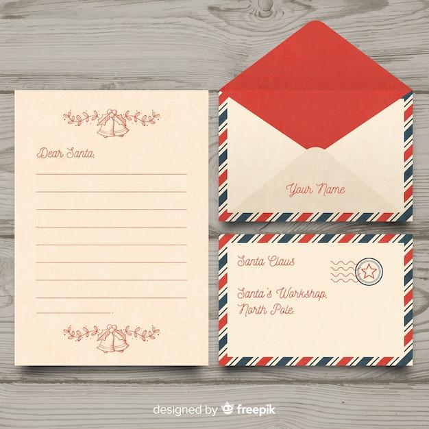 Vintage lieve santa kerst brief en envelop instellen Gratis Vector