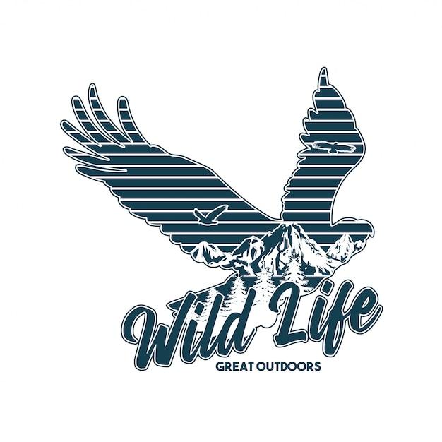 Vintage logo-stijl print kleding ontwerp illustratie met dieren in het wild van amerikaanse adelaar en grote bergen in het silhouet. reizen, kamperen, buiten, natuurlijk, wildernis, verkennen. Premium Vector