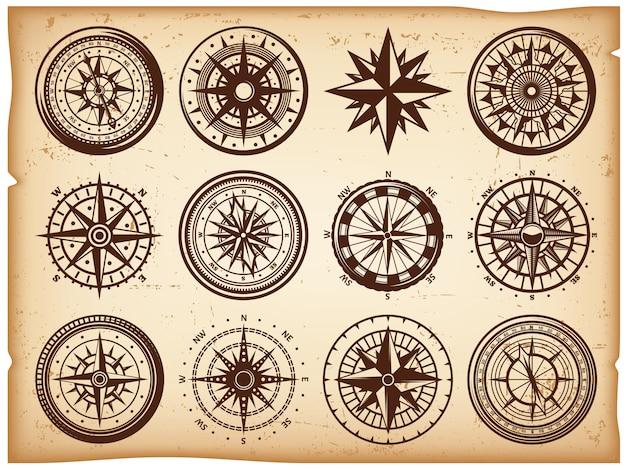 Vintage nautische kompassen pictogrammen instellen Gratis Vector
