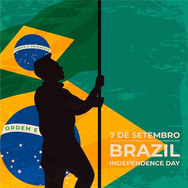 Vintage onafhankelijkheidsdag van brazilië achtergrond met man Gratis Vector