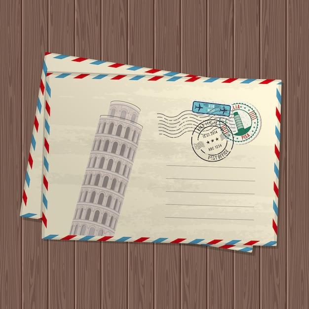 Vintage stijl letters met scheve toren van pisa, merken en postzegels van italië en plaats voor tekst op houten textuur Premium Vector