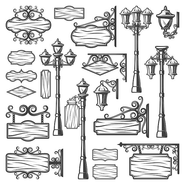 Vintage straat lantaarns set met metalen palen oude lampen uithangborden en lege houten planken geïsoleerd Gratis Vector