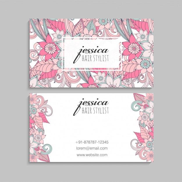 Visitekaartjes sjabloon roze hand getrokken bloemen Gratis Vector