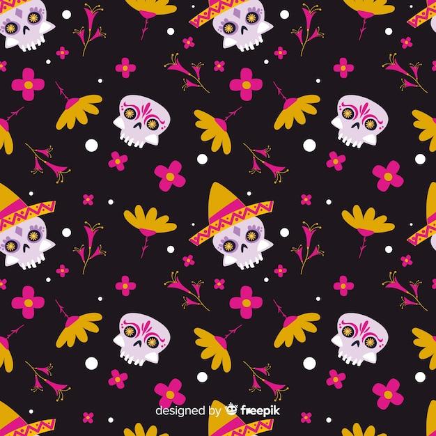 Vlak día de muertos patroon met schedels en bloemen Gratis Vector