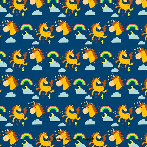 Vlak kleurrijk schattig eenhoornpatroon Gratis Vector
