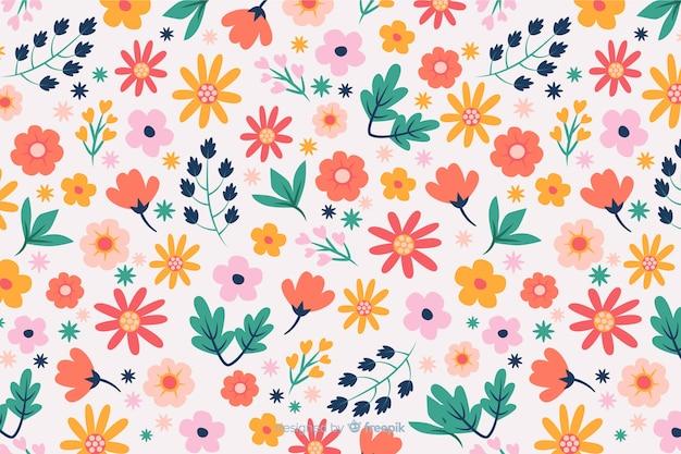 Vlakke kleurrijke bloemen en bladerenachtergrond Premium Vector
