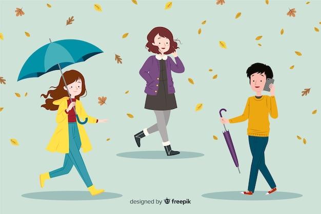 Vlakke mensen die in de herfst lopen Gratis Vector