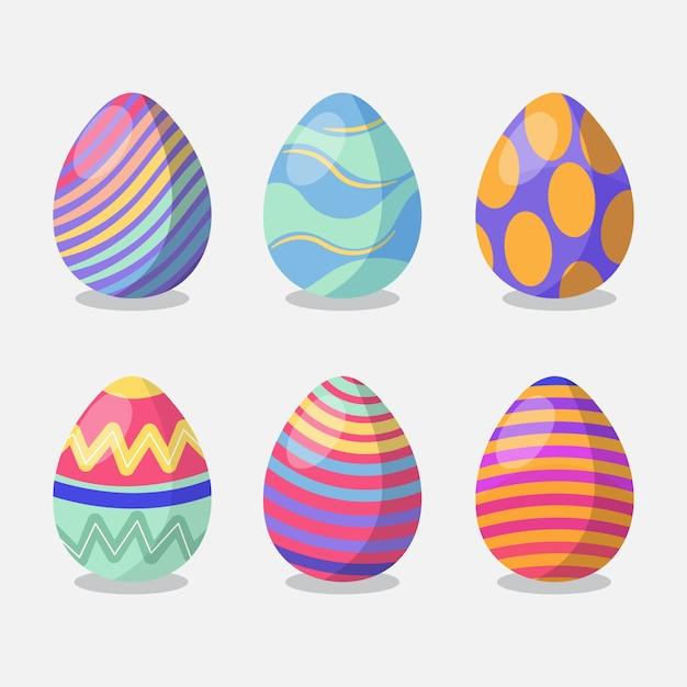 Vlakke paasdag beschilderd eieren pack Gratis Vector