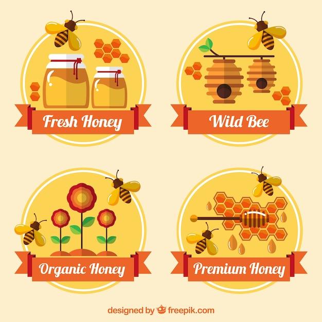 Vlakke stijl badges voor biologische honing Gratis Vector