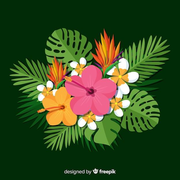 Vlakke tropische bloemen en bladeren Gratis Vector