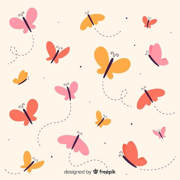 Vlakke vlinders die achtergrond vliegen Gratis Vector