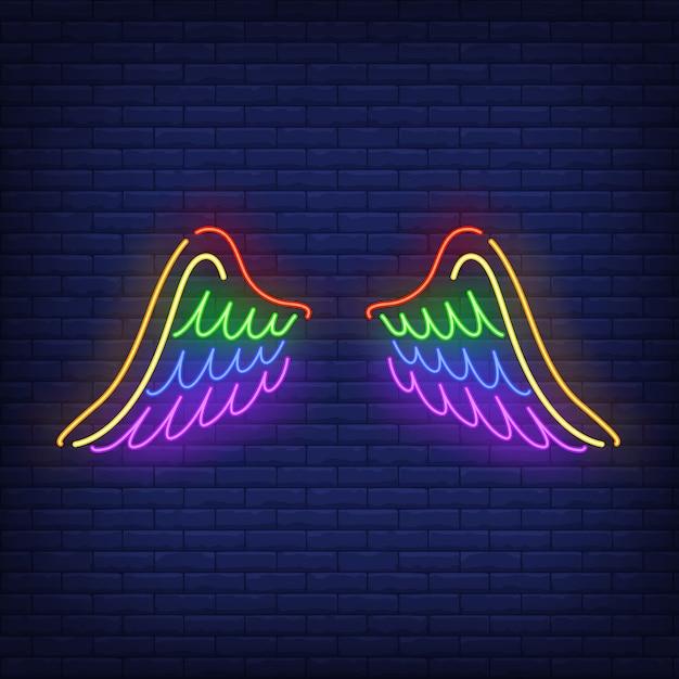 Vleugels met lgbt-kleuren neonteken Gratis Vector