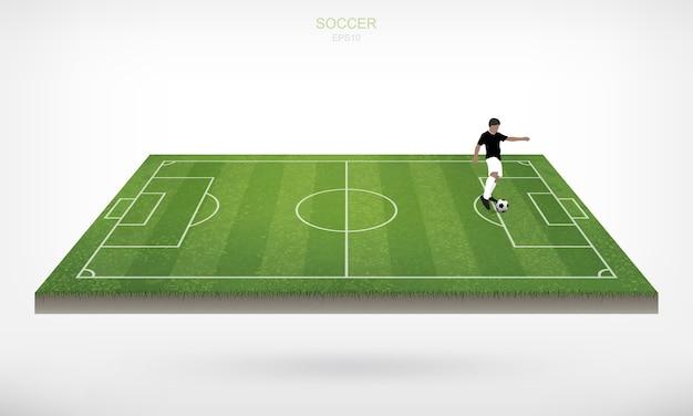 Voetbalspeler en voetbal voetbal bal op voetbalveld. Premium Vector