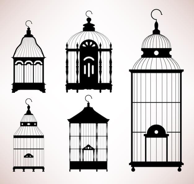 Vogelkooi vogelkooi vintage retro silhouet. een set antiek ontwerp voor vogelkooien. Premium Vector