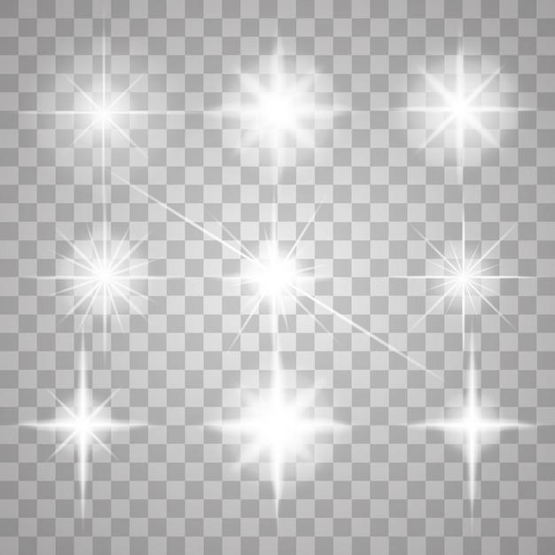 Vonken geïsoleerd. vector gloeiende sterren. lensfakkels en schittert Premium Vector