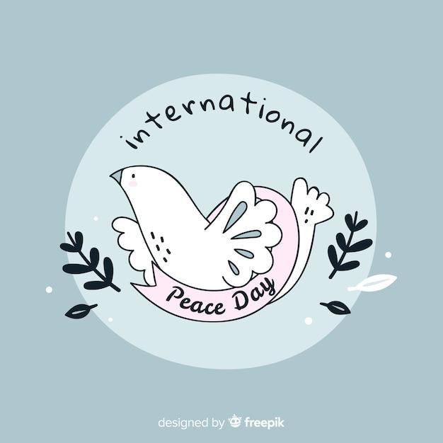 Vredesdag concept met hand getrokken duif Gratis Vector