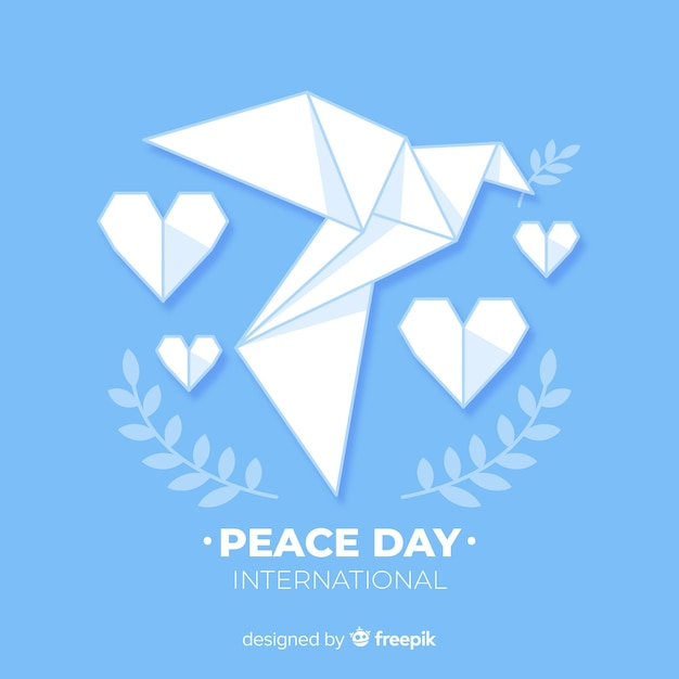 Vredesdag concept met origami duif Gratis Vector