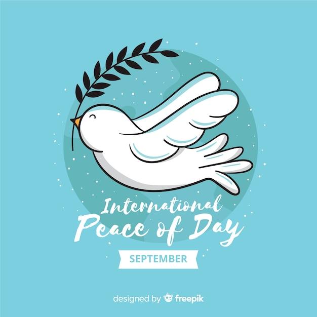 Vredesdag concept met platte ontwerp duif Gratis Vector