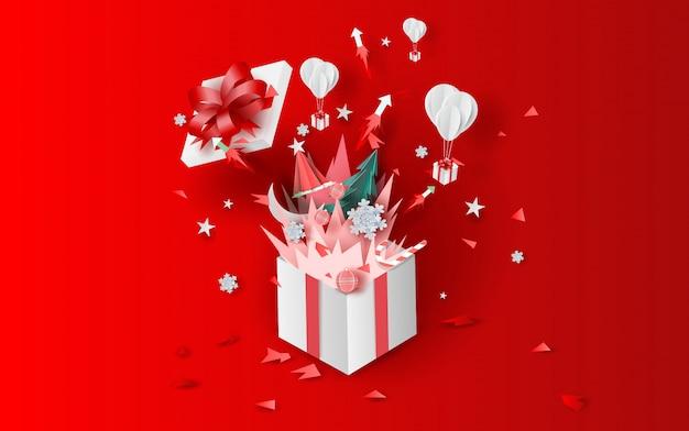 Vreugdevuur kunst kerstmis met geschenkdoos Premium Vector