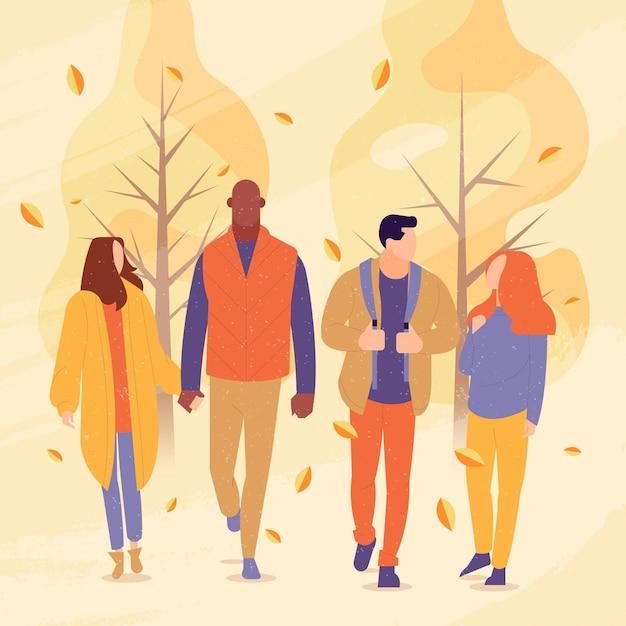 Vrienden wandelen in herfst park Gratis Vector