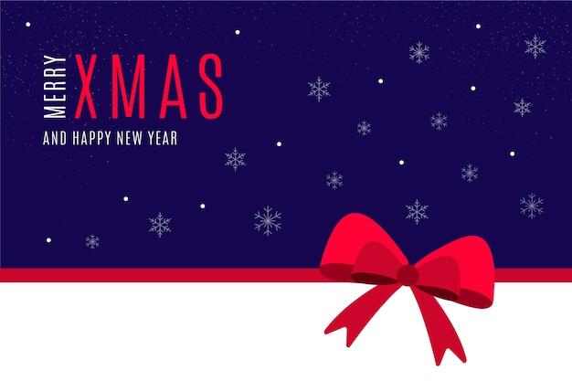 Vrolijk kerstbericht op blauw behang Gratis Vector
