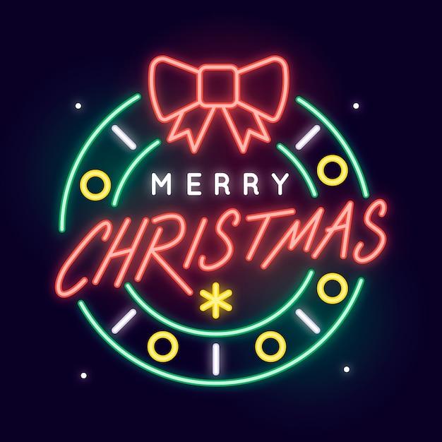 Vrolijk kerstconcept met neonontwerp Gratis Vector