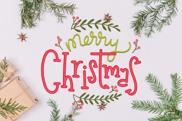 Vrolijk kerstfeest belettering op kerstmis foto Gratis Vector