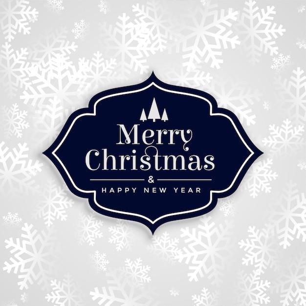Vrolijke elegante witte de sneeuwvlokkenkaart van kerstmis Gratis Vector