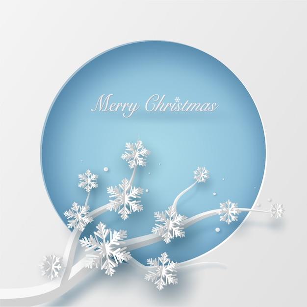 Vrolijke kerstkaart in blauwe cirkelvorm en boomtak. Premium Vector